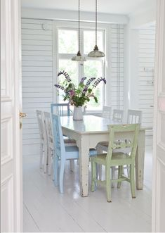 Omg love white floorboards and pastel chairs in dining  room xx