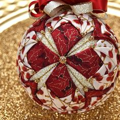 The Ornament Girls Club – Quilted Ornament Kit of the MonthChristmas Carol North Shore Music Theater Simple Christmas Crafts To Make And SellBloom Quilted Ornament Pattern e-Book – No SewArts And Crafts For KindergartenNo automatic alt text avail Quilted Fabric Ornaments, Quilted Christmas Ornaments, Christmas Balls, Handmade Christmas, Christmas Tree Decorations, Christmas Crafts, Christmas Carol, Simple Christmas, Christmas Presents
