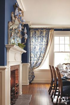 Traditional Blue Dining Room With Wainscoting