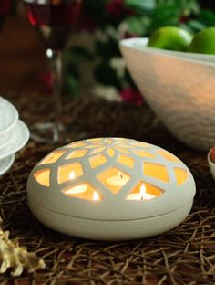 Light up your evening drinks routine with this beautiful ceramic tea light holder. The cut out floral pattern makes for a pleasant play of light and shadow, setting the mood for the evening.