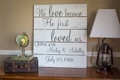 We love because He first loved us. 1 John 4:19 Wood Sign