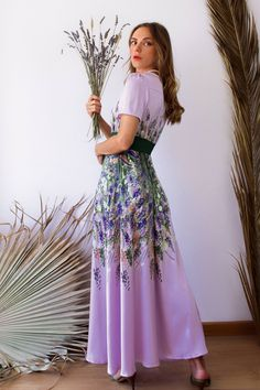 Lavender aesthetic flared dress from a European designer made of satin.  #flaredlongdress, #lavenderaesthetic, #flaredfloraldress