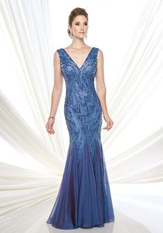 Sleeveless hand-beaded two-tone chiffon fit and flare gown with front and back V-necklines, dropped waistline, chiffon inset skirt. Matching shawl included, as shown wrapped around shoulders.