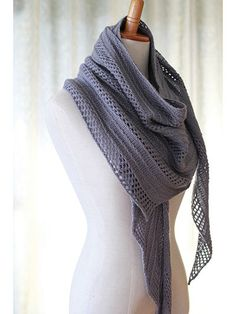 """This asymmetrical, triangular shawl is knit from tip to end and alternates between a slip-stitch and eyelet sections, separated by simple stockinette stitch. Knit with approximately 669 yds of fingering-weight yarn at a gauge of 24 sts per 4"""" us..."""