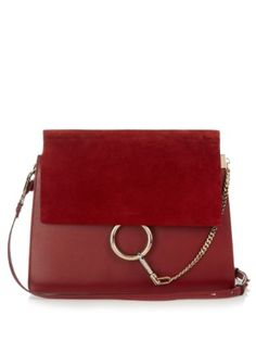 Crafted from rich burgundy calf leather and suede, Chloé's Faye shoulder bag will take a wardrobe seamlessly into autumn. The sizeable body is accented with pale gold-tone metal hardware, while the interior is split into two main compartments for optimum organisation. Let it bring a warm accent to sharp monochrome looks and favourite blue denim.
