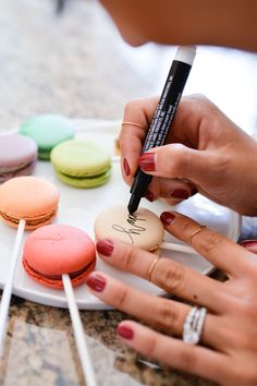 Use macarons to make signs for cake by  Cupcakes & Cutlery!