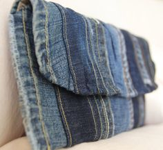 PRODUCT: This listing is for a hip clutch featuring a variety of denim pieces. The clutch closes with a snap and has an interior pocket. Finished