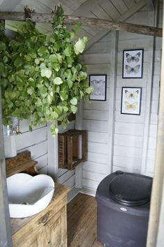 Modern rustic summer cottage style bathroom with a composting toilet. The contrast of the sleek modern sink with the rough wood cabinet really makes this room. Cabin Bathrooms, Outdoor Bathrooms, Outside Toilet, Outdoor Toilet, Cozy Cottage, Cottage Style, Summer Cabins, Composting Toilet, Tiny Cabins