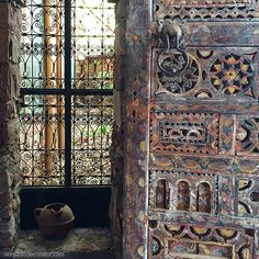 A textured and patterned window scene at an artist's colony outside Marrakech…