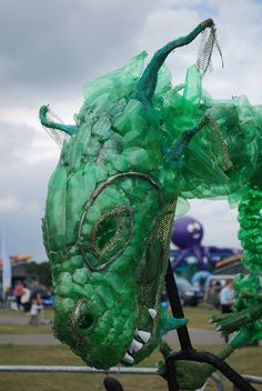 This fierce dragon on a bike is made from  old plastic bottles!