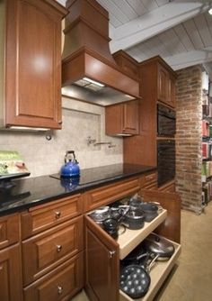 Kitchens by Case Design/Remodeling- I like the large pullout drawers inside cupboard doors as can store taller items and easy access.