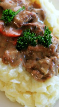 Slow Cooker Beef Stroganoff Recipe ~ magnificent and easy... Delicious tender slices of beef mingled together with onion, mushroom and carrots all floating in a rich and delicious wine infused sour cream gravy.