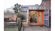 We tend to spend a lot of time searching for creative and independent shipping container builds around the world.  We just came across this very organic looking 20′ shipping container that has been retrofitted into a backyard studio/office.