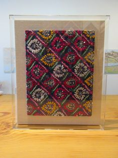 bathroom art ideas: acrylic box frames embroidery float mount onto linen wrapped wood panel