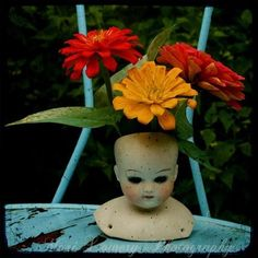 antique doll head flower pot