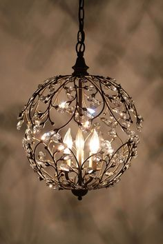 "I'm not a big fan of the whole ""a chandelier in every room"" movement (in the bathroom? really? a chandelier? c'mon now.) - too formal and forced for me. But this sweet little light is humble enough to sneak into Teleute's hideout."