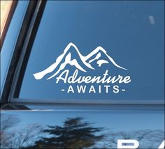 """Adventure Awaits""  with Mountain silhouette Nature Calls, Outdoors, Off Road Recreation, Camping Hiking Climbing Campfire Adventure Mountain Life Mirror Mirror, Magic Mirror, Fitness, Mirror Motivation Vinyl Car Decal: measures approximately 7-1/4""w x 3-3/4""h (18cm x 9.5cm)  This order is f..."