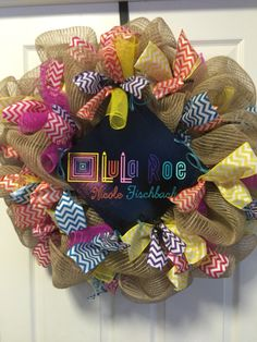 Lularoe decomesh wreath pink purple teal yellow and orange    https://www.facebook.com/ggsdecos/