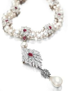 A Cartier pearl, ruby and diamond necklace purchased in 1969. Estimate: $2000000.00 - 3000000.00   The pearl is said to have belonged to Queen Mary (1300s) - Bloody Mary