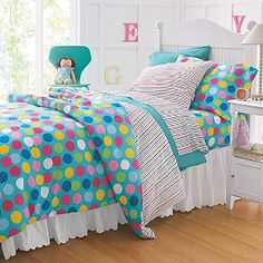 Want to create a totally new room with just the flip of a comforter? This reversible bedding is perfect for you! It features fun gumballs on one side and an exciting rainbow pattern on the other!