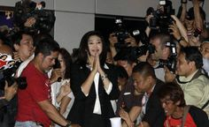 lThe leader of Pheu Thai Party and Thailand's Prime Minister-elect Yingluck Shinawatra acknowledges supporters after winning the election at the party headquarters in Bangkok. File photo
