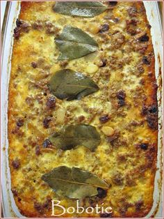 Bobotie is a classic Cape Malay dish from South Africa - gently spiced mince with sultanas and flaked almonds baked under a savoury custard. South African Dishes, South African Recipes, Meat Recipes, Cooking Recipes, Oven Recipes, Recipies, Kos, Master Chef, International Recipes
