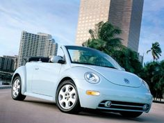 Volkswagen New Beetle-Baby Blue Convertible... This is the car I want for my 16th birthday!!! or for whenever I get my hardship!!
