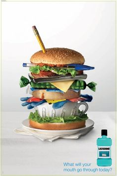 """""""Burgers always catch our eye but this one doesn't look very appetizing. This piece does a great job showing all the things we put into our mouth during the day. Notice how most of the objects aren't even food. Yuk."""""""