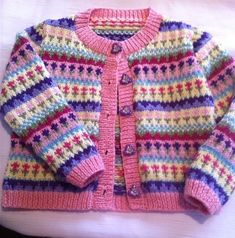 Ravelry: Petite Fleur Fair Isle Cardigan pattern by Audrey Wilson Designed to fit ages: years, years, years. This Pin was discovered by Ruk Intarsia baby button up sweater Discover recipes, home ideas, style inspiration and other ideas to try. Kids Knitting Patterns, Baby Sweater Patterns, Baby Cardigan Knitting Pattern, Crochet Baby Cardigan, Knit Baby Sweaters, Knitting For Kids, Knitting Sweaters, Toddler Cardigan, Baby Jumper
