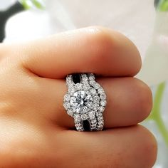 Happy Leap day Friday! Thought of giving someone you love some flowers this week? How about this unique round cut with flower halo and split shank instead. Customize your ring now here at King of Jewelry. :)