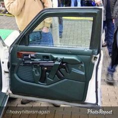 The photo above is of a German police car with an stowed in a custom molded door. However this is not a traditional method of storage for in German police cars. Weapon Storage, Gun Storage, Hidden Storage, Home Defense, Self Defense, German Police, Submachine Gun, Custom Guns, Cool Guns