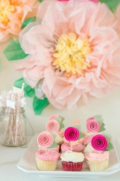Paper floral topped cupcakes: http://www.stylemepretty.com/living/2015/11/13/garden-party-first-birthday/   Photography: Modern Kids - http://www.modernkids.com/