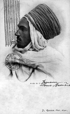 Africa | Portrait of an Arab man from the Plains.  Algeria.  Post dated 1901 || Vintage postcard; photo Jean Geiser