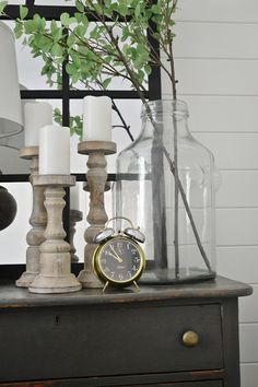 Rustic candlesticks for a natural neutral nightstand.
