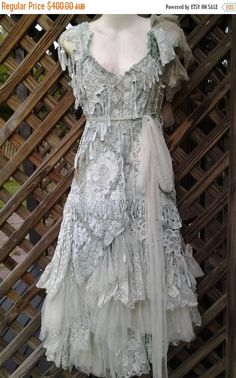 THESE CAN BE MADE WITH LOVE IN ANY SIZE AND COLOR!! these dresses are works of art,labors of love and a gift to lovers of etsy!!! shes a wonderful bohemian vintage inspired dress in pale misty greens giving her an etherial feel!!! lacing up front and back for added charm and fit she has been kissed with a ton of assorted vintage and bridal embroidered decals,bridal fringing,rose trims,butterflies,netting,crochet and crushed my style to add to her old world charm... adjustable pixie shoulder…