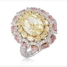thejewellclosetStunning exquisite diamond ring. This ring comprises of oval cut yellow diamond in the center and round cut yellow diamonds surrounding it as well as rectangle cut pink diamonds and white diamonds. @thejewellcloset #agryle #diamond#india #australia #bridal #bride