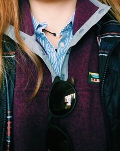 preppy/outdoor: button down, llbean pullover, small necklace, vest