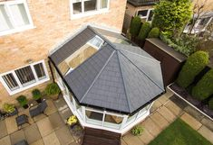 A conservatory with tiled roof offers many advantages that other roofs don't. Find out what these are and how much a conservatory with a tiled roof costs. Tiled Conservatory Roof, Replacement Conservatory Roof, Conservatory Design, Glass Roof Panels, Roof Decoration, France Country, Glass Extension, Uk Homes, Patio Roof