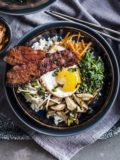 We've given a classic flavour combination a new twist with this bacon and egg bibimbap. Prep all the veg before cooking the rice, so it stays warm while you cook the toppings