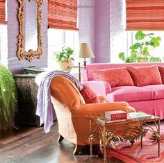 Maybe if it's just a slipcover, I can allow myself a pink couch?  Awesome pink, orange, purple, and gold living room