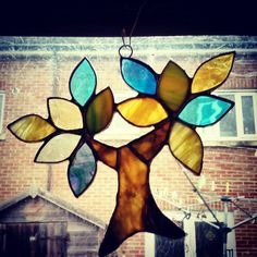 A personal favourite from my Etsy shop https://www.etsy.com/uk/listing/253589799/unique-tree-of-life-stained-glass-sun