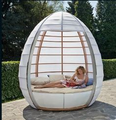 Tisettanta NU-OVO. Halifax Collection > Nu-Ovo > Nu-Ovo. Large, white egg shaped outdoor chair / bed with wooden slats. Perfect for shade from the sun.