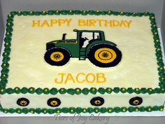 John Deere tractor birthday cake with hand piped tractor and tires                                                                                                                                                     More