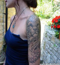 http://tattoomagz.com/lion-face-tattoo-designs/lion-free-tattoo-design-beautiful-lion-tattoos-part-6/