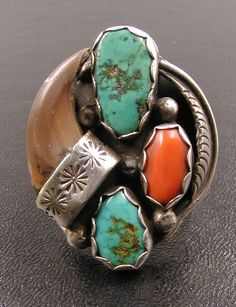 Ring | Designer ? (Navajo) Sterling silver, turquoise, bear claw and coral. | ca 1970s