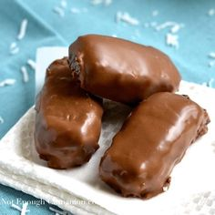 Chocolate + sweetened condensed milk + shredded coconut. That's all you need to make these super simple homemade Bounty Bars aka Mounds! | Find this easy step-by-step recipe on NotEnoughCinnamon.com