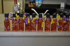 Possibly for the hen party...... Purple Hooter shooters in decorated airplane bottles. 1oz vodka, 1/2 oz sweetened lime juice, 1/2 oz black raspberry liquor.