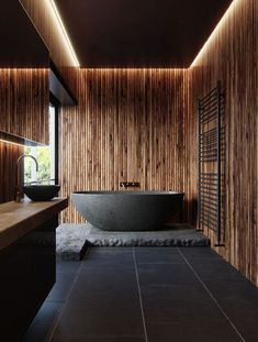 Orgasmic Bathroom. Black tile, black bowl soaker tub, wood salt walls.. zen-fabulous.