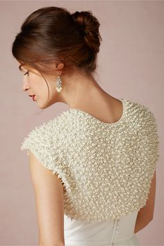 "$220 (sale from $350) @ BHLDN ""Pearlwise Bolero"" sizes small - large. Made by Moyna, a silk jacket encrusted w/ different sized pearly orbs, open front, silk fabric w/ pearl beads, spot clean, imported. Cool close-up - doesn't have to be just for bridal. . ."