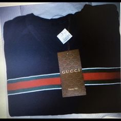 Men's Gucci V neck Polo. Shirt Gucci men's V neck Polo shirt size M, L, X-l comes with tags and receipts Gucci Sweaters V-Necks